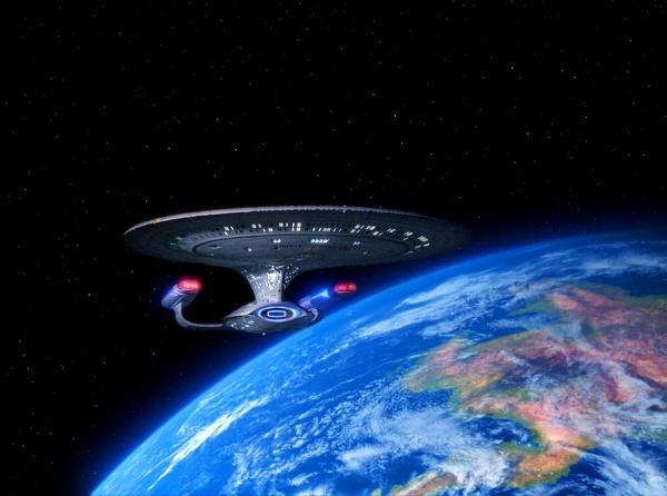 Die Enterprise D in der Umlaufbahn um die Vergnügungswelt Risa