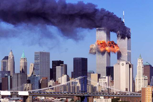 FIFTH IN A PACKAGE OF NINE PHOTOS.-- An explosion rips through the South Tower of the World Trade Towers after the hijacked United Airlines Flight 175, which departed from Boston en route for Los Angeles, crashed into it Sept, 11, 2001. The North Tower is shown burning after American Airlines Flight 11 crashed into the tower at 8:45 a.m. (AP Photo/Aurora, Robert Clark)