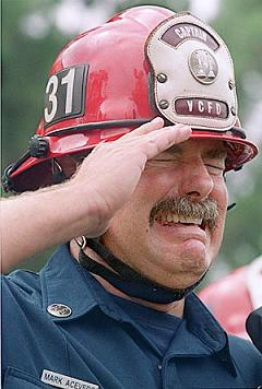 153758_1.tif. Ventura County Fire Department Capt. Mark Acevedo reacts Tuesday, Sept. 18, 2001, during a memorial service at the Government Center in Ventura, Calif., honoring the rescue personnel who died trying to save the victims of the World Trade Center towers. (AP Photo/Ventura County Star, James Glover II)